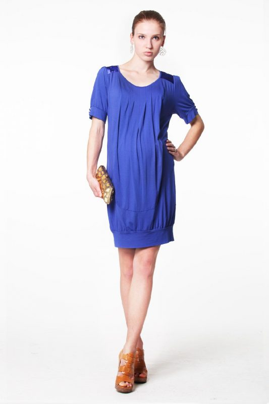 Pregnant mannequin wearing Venetia Kole Alexa Drape Maternity Dress in blue