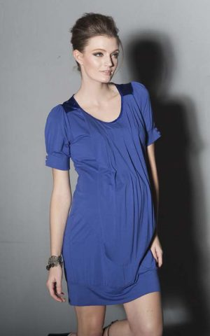 Pregnant model wearing Venetia Kole Alexa Drape Maternity Dress in blue