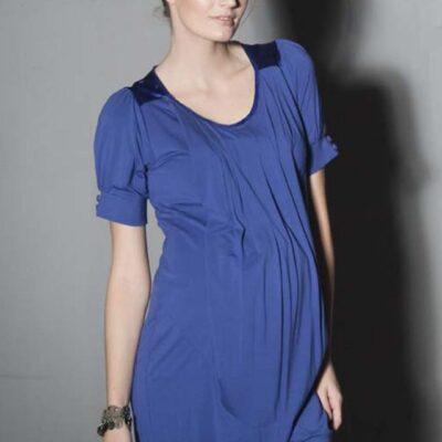 Pregnant model wearing Venetia Kole Alexa Drape Maternity Dress in blue