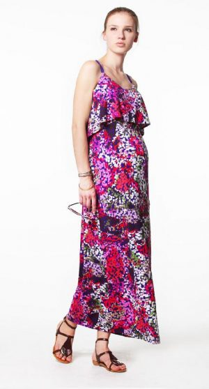 Pregnant model wearing Venetia Kole Gretta Maxi Maternity Dress multicolour pixel pattern