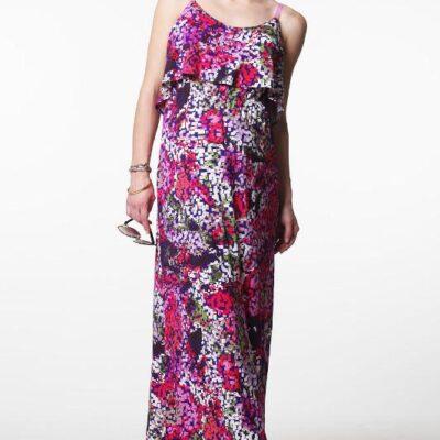 Pregnant model wearing Venetia Kole Gretta Maxi Maternity Dress multicolour pixel pattern