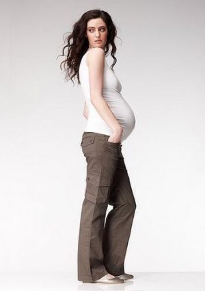 Model wearing Soon Band Cargo Maternity Pants in khaki