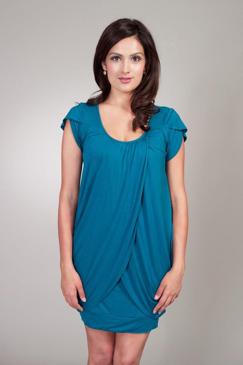 Woman wearing a teal petal breastfeeding dress