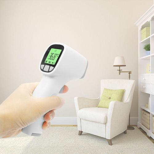 digital baby thermometer in use in bedroom