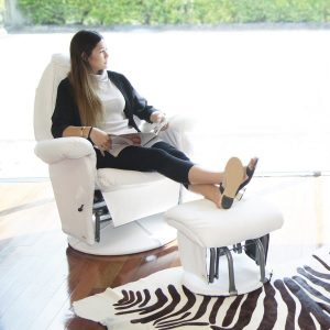 vogue glider feeding chair with mum relaxing