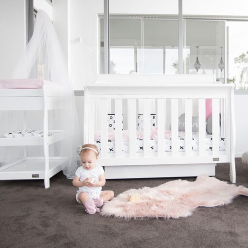 Armani Sleigh cot with baby on floor