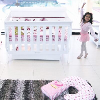 amani sleigh cot in bedroom setting with white cot