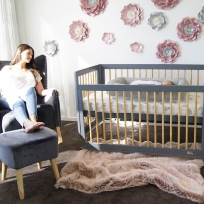 riya cot in bassinet mode with mum and baby in nursery