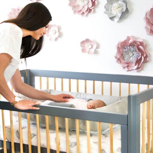 riya cot in grey and natural with mum and baby