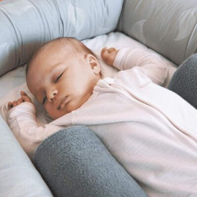 breathe eze sleep positioner in the cosy crib